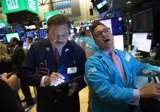 Stock traders John Santiago, left, and Paul Cosentino work at the New York Stock Exchange, Wednesday, Sept. 18, 2019. The Federal Reserve is expected to announce its benchmark interest rate later in the day. (AP Photo/Mark Lennihan)