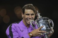 Rafael Nadal, of Spain, poses with the championship trophy after defeating Daniil Medvedev, of Russia, to win the men's singles final of the U.S. Open tennis championships Sunday, Sept. 8, 2019, in New York. (AP Photo/Charles Krupa)