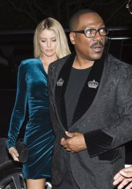 """Actor Eddie Murphy arrives with his girlfriend Paige Butcher on the red carpet for the new movie """"Dolemite Is My Name"""" in Toronto, on Saturday, Sept. 7, 2019. (Nathan Denette/The Canadian Press via AP)"""
