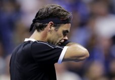 ger Federer, of Switzerland, reacts after missing a point during the fifth set against Grigor Dimitrov, of Bulgaria, during the quarterfinals of the U.S. Open tennis tournament Tuesday, Sept. 3, 2019, in New York. (AP Photo/Charles Krupa)