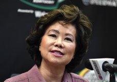 FILE - In this July 13, 2019, file photo, Transportation Secretary Elaine Chao addresses the media before the NASCAR series auto race at Kentucky Speedway in Sparta, Ky. The House Oversight Committee says it is investigating whether Chao acted improperly to benefit herself or her family's shipping company. (AP Photo/Timothy D. Easley, File)