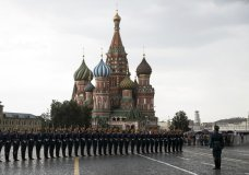 FILE - In this June 30, 2018, file photo, Kremlin guards perform in Red Square with St. Basil's Cathedral in the background in Moscow, Russia. A negotiating team from the Taliban arrived in Russia, just days after U.S. President Donald Trump declared dead a deal with the insurgent group in Afghanistan, a representative said Friday, Sept. 13, 2019. (AP Photo/Pavel Golovkin, File)
