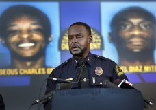 Dallas Assistant Chief of Police Avery Moore addresses the media about a drug deal gone bad resulting in the death of Joshua Brown. The police are still looking for suspects Thaddeous Charles Green and Michael Diaz Mitchell. They already have Mitchell's nephew, Jacquerious Mitchell, in custody. Brown, who was a neighbor of Botham Jean at the South Side Flats, was also a character witness in the Amber Guyger trial. The press conference was held at Dallas Police Headquarters in Dallas, Tuesday, Oct. 8, 2019. (Tom Fox/The Dallas Morning News via AP)