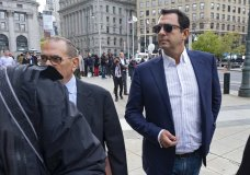 Andrey Kukushkin, right, leaves federal court, Thursday, Oct. 17, 2019, in New York. Kukushkin and David Correia pleaded not guilty Thursday to conspiring with associates of Rudy Giuliani to make illegal campaign contributions. They are among four men charged with using straw donors to make illegal contributions to politicians they thought could help their political and business interests. (AP Photo/Craig Ruttle)