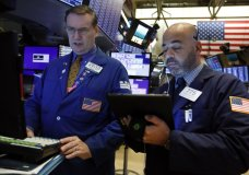 FILE - In this Oct. 7, 2019, file photo specialist Patrick King, left, and trader Fred DeMarco work on the floor of the New York Stock Exchange. The U.S. stock market opens at 9:30 a.m. EDT on Monday, Oct. 28. (AP Photo/Richard Drew, File)