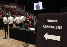 FILE - In this Tuesday, June 4, 2019, file photo, managers wait for job applicants at the Seminole Hard Rock Hotel & Casino Hollywood during a job fair in Hollywood, Fla. A measure of hiring by U.S. companies has fallen to a seven-year low and fewer employers are raising pay, a business survey released Monday, Oct. 28, 2019, has found. Just one-fifth of the firms surveyed by the National Association for Business Economics said they have hired additional workers in the past three months. (AP Photo/Wilfredo Lee, File)