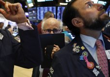 Trader Peter Tuchman, center, works on the floor of the New York Stock Exchange, Monday, Nov. 4, 2019. Stocks are opening higher on Wall Street, pushing major indexes toward more record highs. (AP Photo/Richard Drew)