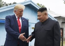"FILE - In this June 30, 2019, file photo, North Korean leader Kim Jong Un, right, and U.S. President Donald Trump prepare to shake hands at the border village of Panmunjom in the Demilitarized Zone, South Korea. On Wednesday, Nov. 13, 2019, North Korea's supreme decision-making institution has lashed out at planned U.S.-South Korean drills and warned that the United States will face ""bigger threat and harsh suffering"" if it ignores North Korean leader Kim Jong Un's end-of-year deadline to salvage the nuclear diplomacy. (AP Photo/Susan Walsh, File)"