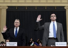 Ambassador Kurt Volker, left, former special envoy to Ukraine, and Tim Morrison, a former official at the National Security Council are sworn in to testify before the House Intelligence Committee on Capitol Hill in Washington, Tuesday, Nov. 19, 2019, during a public impeachment hearing of President Donald Trump's efforts to tie U.S. aid for Ukraine to investigations of his political opponents. (AP Photo/Susan Walsh)