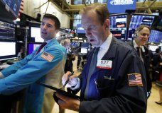 FILE - In this Oct. 30, 2019, file photo specialist Thomas McArdle, left, and trader Michael Smyth, center, work on the floor of the New York Stock Exchange. The U.S. stock market opens at 9:30 a.m. EST on Thursday, Nov 7. (AP Photo/Richard Drew, File)