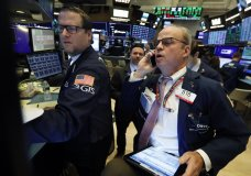 FILE - In this Nov. 7, 2019, file photo specialist Gregg Maloney, left, and trader David O'Day work on the floor of the New York Stock Exchange. The U.S. stock market opens at 9:30 a.m. EST on Monday, Nov 11. (AP Photo/Richard Drew, File)