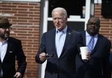 Democratic presidential hopeful Joe Biden, center, leaves Food for the Soul restaurant with South Carolina Democratic Party Chairman Trav Robertson, left, and state director Kendall Corley, right, after filing paperwork for the South Carolina primary on Friday, Nov. 22, 2019, in Abbeville, S.C. (AP Photo/Meg Kinnard)