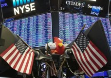 FILE - In this Sept. 18, 2019, file photo, stock prices are displayed at the New York Stock Exchange. U.S. stocks pushed upward in early trading Friday, Nov. 22, 2019, following a global tide higher, as a week clouded by uncertainty about progress in U.S.-China trade talks comes to a close. (AP Photo/Mark Lennihan, File)