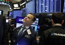 FILE - In this Nov. 14, 2019, file photo trader John Elliott works on the floor of the New York Stock Exchange. The U.S. stock market opens at 9:30 a.m. EST on Tuesday, Dec. 3. (AP Photo/Richard Drew, File)