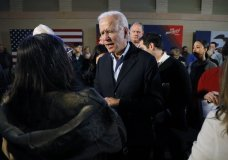Democratic presidential candidate former Vice President Joe Biden greets audience members during a bus tour stop, Tuesday, Dec. 3, 2019, in Mason City, Iowa. (AP Photo/Charlie Neibergall)