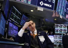 FILE - In this Jan. 15, 2020, file photo specialist Peter Mazza works at his post on the floor of the New York Stock Exchange. The U.S. stock market opens at 9:30 a.m. EST on Thursday, Jan. 23. (AP Photo/Richard Drew, File)