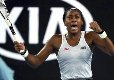 "United States' Cori ""Coco"" Gauff reacts during her first round singles match against compatriot Venus Williams at the Australian Open tennis championship in Melbourne, Australia, Monday, Jan. 20, 2020. (AP Photo/Dita Alangkara)"