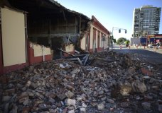 Debris from a collapsed wall of a building litters the ground after an earthquake struck Puerto Rico before dawn, in Ponce, Puerto Rico, Tuesday, Jan. 7, 2020. (AP Photo/Carlos Giusti)