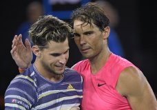 Austria's Dominic Thiem, left, is congratulated by Spain's Rafael Nadal after winning their quarterfinal match at the Australian Open tennis championship in Melbourne, Australia, Wednesday, Jan. 29, 2020. (AP Photo/Andy Brownbill)