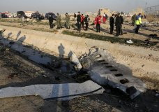 "FILE - In this Jan. 8, 2020, photo, debris is seen from an Ukrainian plane which crashed as authorities work at the scene in Shahedshahr, southwest of the capital Tehran, Iran. Iran announced Saturday, Jan. 11, that its military ""unintentionally"" shot down the Ukrainian jetliner that crashed earlier this week, killing all 176 aboard, after the government had repeatedly denied Western accusations that it was responsible. (AP Photo/Ebrahim Noroozi, File)"