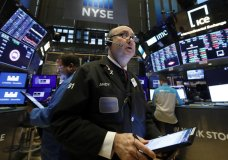 FILE - In this Jan. 10, 2020, file photo trader Andrew Silverman works on the floor of the New York Stock Exchange. The U.S. stock market opens at 9:30 a.m. EST on Wednesday, Jan. 15. (AP Photo/Richard Drew)