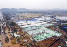 The Huoshenshan temporary field hospital under construction is seen as it nears completion in Wuhan in central China's Hubei Province, Sunday, Feb. 2, 2020. The Philippines on Sunday reported the first death from a new virus outside of China, where authorities delayed the opening of schools in the worst-hit province and tightened quarantine measures in a city that allow only one family member to venture out to buy supplies. (Chinatopix via AP)