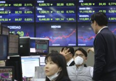 A currency trader wears a face mask at the foreign exchange dealing room of the KEB Hana Bank headquarters in Seoul, South Korea, Monday, Feb. 24, 2020. (AP Photo/Ahn Young-joon)