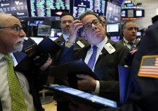 Sal Suarino, center, works with fellow traders on the floor of the New York Stock Exchange, Tuesday, March 10, 2020. Stocks, Treasury yields and oil are clawing back some of the plunge they took a day before, when the S&P 500 had its worst drop in more than a decade. (AP Photo/Richard Drew)