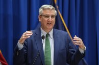 FILE - In this March 24, 2020 file photo, Indiana Gov. Eric Holcomb answers questions at the Statehouse in Indianapolis. Seven Midwestern governors announced Thursday, April 16, 2020 that they will coordinate on reopening their state economies amid the coronavirus pandemic, after similar pacts were made in the Northeast and on the West Coast. The latest agreement includes Illinois, Ohio, Michigan, Indiana, Wisconsin, Minnesota and Kentucky. (AP Photo/Michael Conroy File)