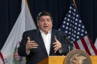 FILE - In this April 13, 2020 file photo, Illinois Gov. J.B. Pritzker gives a daily state update on the coronavirus outbreak in Chicago. Seven Midwestern governors announced Thursday, April 16, 2020 that they will coordinate on reopening their state economies amid the coronavirus pandemic, after similar pacts were made in the Northeast and on the West Coast. The latest agreement includes Illinois, Ohio, Michigan, Indiana, Wisconsin, Minnesota and Kentucky.(Tyler LaRiviere/Chicago Sun-Times via AP File)