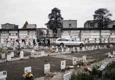 Mourners follow a hearse for a burial at the Monumental cemetery in Turin, Northern Italy, Monday, April 20, 2020 as the Piedmont region remains one of Northern Italy's areas worst-hit by the COVID-19 pandemic. The European Center for Disease Control says the continent now has more than 1 million confirmed cases and almost 100,000 deaths from the coronavirus. (Marco Alpozzi/LaPresse via AP)