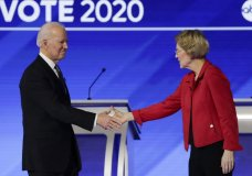 FILE- In this Feb. 7, 2020 file photo, Democratic presidential candidates former Vice President Joe Biden, and Sen. Elizabeth Warren, D-Mass., shake hands on stage before the start of a Democratic presidential primary debate hosted by ABC News, Apple News, and WMUR-TV at Saint Anselm College in Manchester, N.H. Warren has endorsed Joe Biden, becoming the last of the former vice president's major Democratic presidential rivals to formally back him.(AP Photo/Charles Krupa)