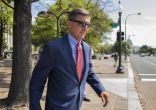 FILE - In this Sept. 10, 2019 file photo, Michael Flynn, President Donald Trump's former national security adviser, leaves the federal court following a status conference in Washington. (AP Photo/Manuel Balce Ceneta)
