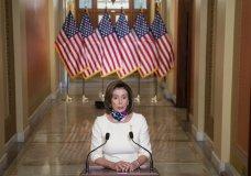"FILE - In this Tuesday, May 12, 2020 file photo, House Speaker Nancy Pelosi, D-Calif., speaks about the ""Heroes Act"" on Capitol Hill in Washington. On Friday, May 15, 2020, The Associated Press reported on stories circulating online incorrectly asserting that Pelosi is trying to pass a law called HR6666 which would allow people to come into your home and take your family members for quarantine. House bill 6666, the COVID-19 Testing, Reaching, And Contacting Everyone (TRACE) Act, clearly states that individuals who test positive during testing for COVID-19 would quarantine at their residences. (Saul Loeb/Pool via AP)"