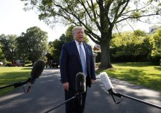 FILE - In this May 15, 2020, file photo President Donald Trump speaks with reporters as he departs the White House on Marine One in Washington. (AP Photo/Alex Brandon, File)