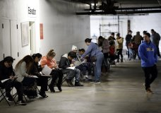 FILE - In this March 13, 2020, file photo, unionized hospitality workers wait in line in a basement garage to apply for unemployment benefits at the Hospitality Training Academy in Los Angeles. California's unemployment rate nearly tripled in April because of the economic fallout from coronavirus pandemic. (AP Photo/Marcio Jose Sanchez, File)
