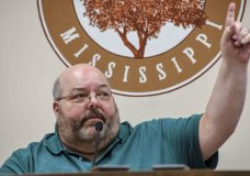 Petal Mayor Hal Marx raises his hand and refuses to resign at a special board of aldermen meeting at Petal City Hall, Thursday, May 28, 2020, in Petal, Miss., over comments he made about the death of Minneapolis man George Floyd at the hands of police, on social media. (Cam Bonelli/Hattiesburg American via AP)