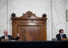 Chairman Sen. Ron Johnson, R-Wis., left, accompanied by Ranking Member Sen. Gary Peters., right, speaks as the Senate Homeland Security and Governmental Affairs committee meets on Capitol Hill in Washington, Wednesday, May 20, 2020, to issue a subpoena Blue Star Strategies. (AP Photo/Andrew Harnik)