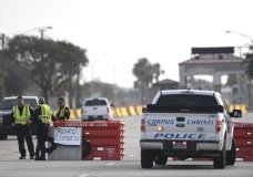 "The entrances to the Naval Air Station-Corpus Christi are closed following an active shooter threat, Thursday, May 21, 2020, in Corpus Christi, Texas. Naval Air Station-Corpus Christi says the shooter was ""neutralized"" and the facility is on lockdown. (Annie Rice/Corpus Christi Caller-Times via AP)"