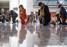 House Speaker Nancy Pelosi of Calif., center, and other members of Congress gather at the Emancipation Hall, kneel and observe a moment of silence to honor George Floyd, and victims of racial injustice, Monday, June 8, 2020, in Washington. (AP Photo/Manuel Balce Ceneta)