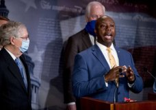 Sen. Tim Scott, R-S.C., right, accompanied by Senate Majority Leader Mitch McConnell of Ky., left, Sen. John Cornyn, R-Texas, center, and others, speaks at a news conference to announce a Republican police reform bill on Capitol Hill, Wednesday, June 17, 2020, in Washington. (AP Photo/Andrew Harnik)