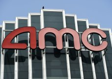 FILE - In this April 29, 2020 file photo, the AMC sign appears at AMC Burbank 16 movie theater complex in Burbank, Calif. The nation's largest movie theater chain changed its position on mask-wearing less than a day after the company became a target on social media for saying it would defer to local governments on the issue. AMC Theaters CEO Adam Aron said Friday that its theaters will require patrons to wear masks upon reopening, which will begin in July. (AP Photo/Chris Pizzello, File)