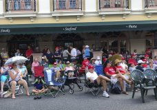 "FILE - In this Oct. 3, 2019 file photo, supporters of President Donald Trump wait outside in a town square in The Villages, Fla., before an appearance by the president. There has always been a low-boil tension in The Villages between the Republican majority and the much smaller cohort of Democrats, but a veneer of good manners in ""Florida's Friendliest Hometown"" mostly prevailed on golf courses and at bridge tables. Those tensions got international attention last weekend when President Donald Trump tweeted approvingly of a video showing one of his supporters at the retirement community chanting a racist slogan associated with white supremacists. (AP Photo/Mike Schneider, File)"