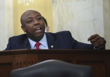 FILE - In this June 10, 2020, file photo, Sen. Tim Scott, R-S.C., speaks during a Senate Small Business and Entrepreneurship hearing to examine implementation of Title I of the CARES Act, on Capitol Hill in Washington. Initially reluctant to speak on race, Scott is now among the Republican Party's most prominent voices teaching his colleagues what it's like to be a Black man in America.(Kevin Dietsch/Pool via AP)