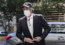 FILE- In this May 21, 2020 file photo, Michael Cohen arrives at his Manhattan apartment in New York after being furloughed from prison because of concerns over the coronavirus. A judge ordered the release from prison, Thursday, July 23 of President Donald Trump's former personal lawyer, saying he believes the government retaliated against him for writing a book about Trump. Cohen sued federal prison officials including Attorney General William Barr on Monday, July 20 saying he was returned to an Otisville, New York, prison to stop him from publishing a tell-all book about his experiences with Trump. (AP Photo/John Minchillo, File)