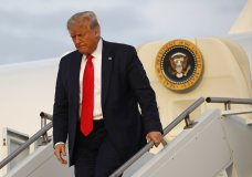 FILE - In this July 24, 2020, file photo President Donald Trump steps off Air Force One at Morristown Municipal Airport in Morristown, N.J. A new poll by The Associated Press-NORC Center for Public Affairs Research shows that at a pivotal moment for President Donald Trump, he is out of step with the country on the most important issues facing it. (AP Photo/Patrick Semansky, File)