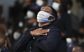A woman becomes emotional during the funeral service for the late Rep. John Lewis, D-Ga., at Ebenezer Baptist Church in Atlanta, Thursday, July 30, 2020. (Alyssa Pointer/Atlanta Journal-Constitution via AP, Pool)