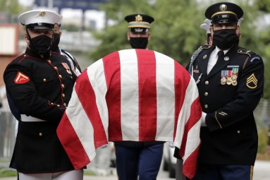 A military honor guard moved the casket of Rep. John Lewis into Ebenezer Baptist Church for his funeral, Thursday, July 30, 2020, in Atlanta. Lewis, who carried the struggle against racial discrimination from Southern battlegrounds of the 1960s to the halls of Congress, died Friday, July 17, 2020. (AP Photo/Brynn Anderson)
