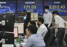 Currency traders watch monitors at the foreign exchange dealing room of the KEB Hana Bank headquarters in Seoul, South Korea, Thursday, July 23, 2020. Shares were mixed in Asia on Thursday, with the region's biggest market in Tokyo closed for a four-day weekend. (AP Photo/Ahn Young-joon)