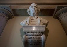 FILE - In this March 9, 2020, file photo a marble bust of Chief Justice Roger Taney is displayed in the Old Supreme Court Chamber in the U.S. Capitol in Washington. The House will vote Wednesday, July 22, on whether to remove from the U.S. Capitol a bust of Chief Justice Roger B. Taney, the author of the 1857 Dred Scott decision that declared African Americans couldn't be citizens. (AP Photo/J. Scott Applewhite, File)